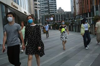Beijing won't require proof of COVID-19 test for some residents leaving city