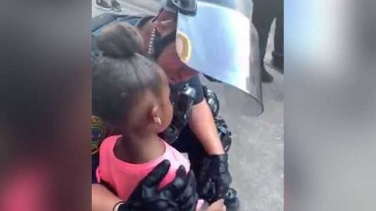 Viral video shows heartwarming moment as cop comforts 5-year-old girl at George Floyd rally in Texas