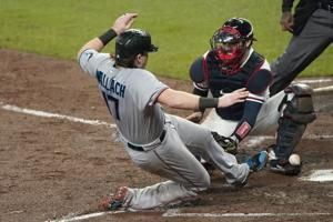 López, Marlins boost playoff hopes by beating Braves 4-2