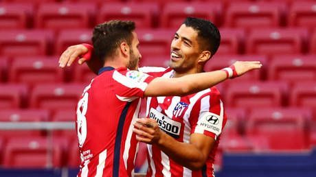 'They could be perfect match': Suarez scores twice on Atletico debut as fans predict unwanted star will 'come back to bite Barca'