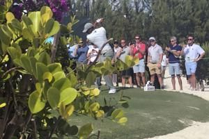 Woodland leads in the Bahamas as Tiger gets within 2 shots
