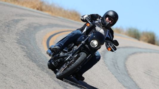 Go throw your leg over something, find an empty road with a few corners, and scrape some pegs