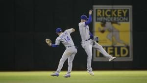 A's waste late lead to Royals, lead over Tampa Bay down to 1