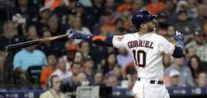 Astros hit 5 homers to end skid with 12-1 win over Rockies