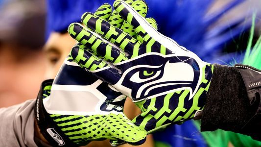 Does Michigan State's new uniform feature Seattle Seahawks gloves?