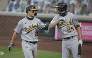 A's use big 5th inning to cruise past Mariners 11-1