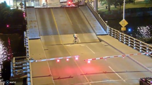 Video shows bicyclist falling into Wisconsin drawbridge gap