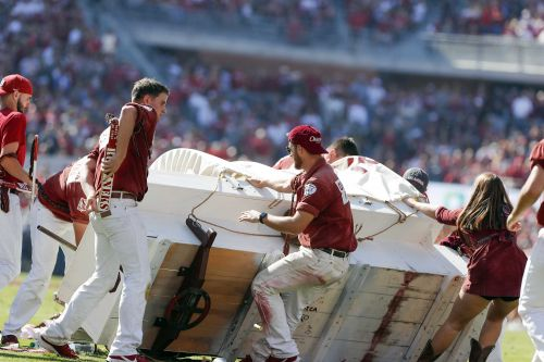 College team's horse-drawn wagon crashes after touchdown during football game