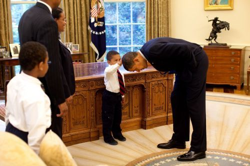 That iconic photo of Obama bending over so a boy could feel his hair was taken just over 10 years ago. Here's the moving story behind it