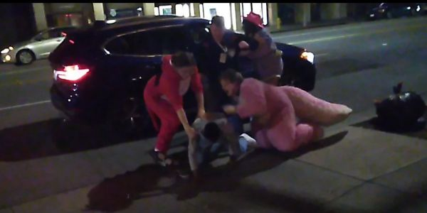 A group of 'furries' in costume rescued a woman allegedly being assaulted by a man outside FurCon