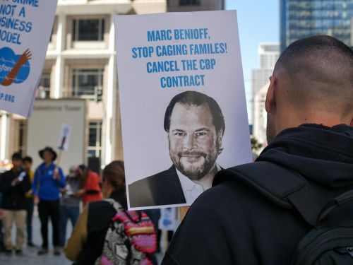 Activists marched outside of the Salesforce headquarters in San Francisco to protest the company's contract with U.S. Customs and Border Protection