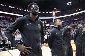 Heat's Winslow fined $15,000 for stepping on Embiid's mask