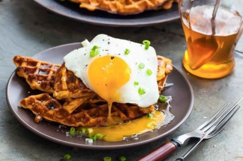 Sweet Potato Waffles with Fried Egg, Bacon, and Scallions