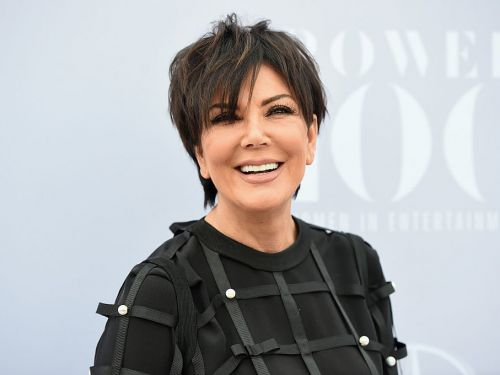 Kris Jenner's walk-in closet is basically a luxury apartment filled with designer handbags and clothes