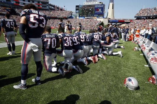 Photos: New England Patriots kneel during national anthem at Gillette Stadium