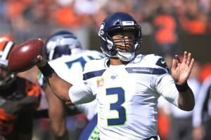 Road crew: Wilson's 3 TDs rally Seahawks past sloppy Browns