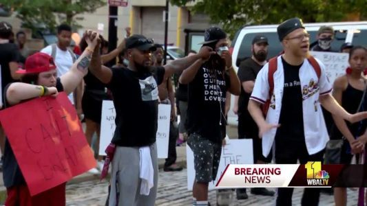 Protesters march to City Hall, demanding justice in George Floyd case