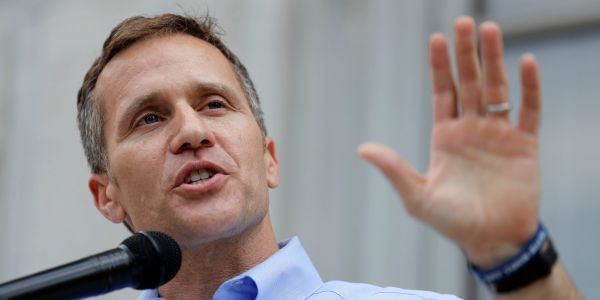 Emabattled Missouri Gov. Eric Greitens, who faces allegations of sexual misconduct, has been charged with a felony in a separate case