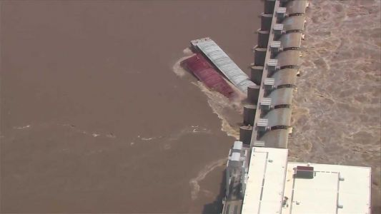 WATCH: Two loose barges slam into Oklahoma dam