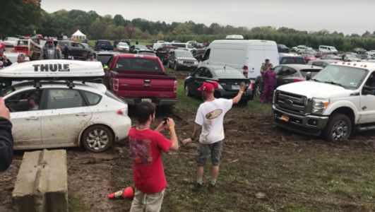 Watch a Subaru Impreza Pull a Ford F-350 Stuck in the Mud