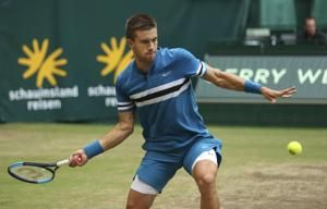 Coric ends Federer's winning streak to take Halle title